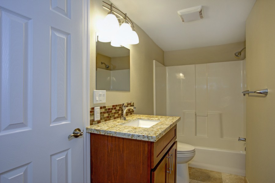 Stunning bathroom with mosaic tile backsplash.